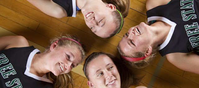 The Casady and Frantz sisters, two sets of twins on the Free State girls basketball team, have opposing defenses seeing double. Pictured clockwise from top are Chelsea Casady, Summer Frantz, Abbey Casady and Ariana Frantz.