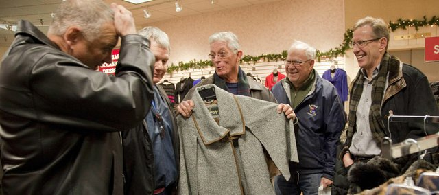 Carrying on a tradition from left, son-in-law Stan Thompson, of Olathe scratches his head as son Pat Osness, of Denver, son-in-law Rod Peck, of San Diego, Cal., Wayne Osness, of Lawrence and son-in-law Owen Buckley, of Kansas City, Mo., did their annual Christmas shopping at Weavers as the foursome meets for lunch and then they walk down town Lawrence and do their Christmas shopping.
