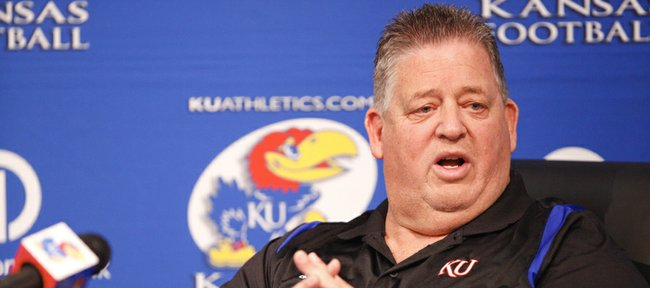 Kansas University football coach Charlie Weis discusses KUs recently signed junior-college transfers at a news conference on Thursday, Dec. 20, 2012, at KU.