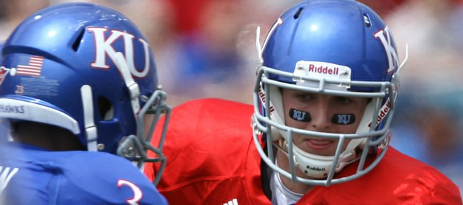 Kansas redshirt quarterback Jake Heaps looks to hand off to running back Tony Pierson during the first half of the Spring Game on Saturday, April 28, 2012 at Kivisto Field.