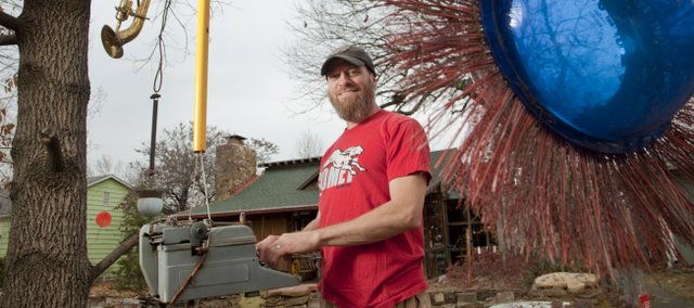 Nick Schmiedeler has a yard and house decorated with junkyard treasures and other assorted stuff. Schmiedeler&#39;s home is one of two Lawrence residences scheduled to be featured on upcoming episodes of HGTV&#39;s &quot;Home Strange Home.&quot;