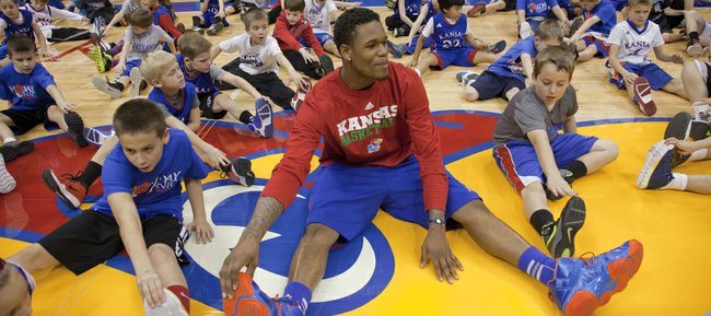 KU freshman Ben McLemore stretches among hundreds of kids in attendance at the annual KU men's basketball clinic on Thursday, Dec. 27, 2012, at Allen Fieldhouse.