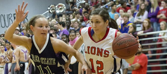 Lawrence High's Emma Kelly (12) drives past Kennedy Kirkpatrick during Lawrence High's game against Free State, Friday, Dec. 14, 2012 at LHS.
