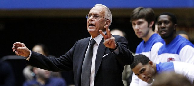 In this photo from Nov. 28, 2012, SMU head coach Larry Brown instructs his team against Utah in Salt Lake City. The well-traveled coach  who led Kansas University to the 1988 NCAA crown  has SMU off to a 9-4 start.