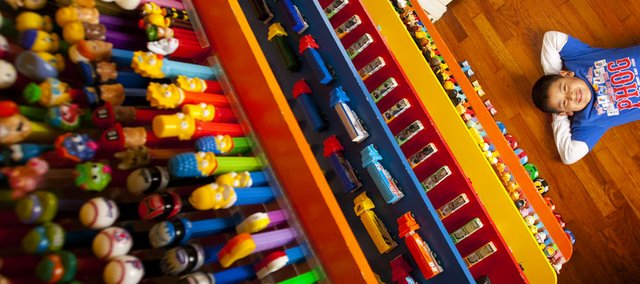 Seven-year-old Isaac Godsey is pictured below six shelves of his nearly 700-piece Pez dispenser collection. Deacon Godsey, Isaac's father, began collecting the dispensers in 1996 and decided to give them to his son for Christmas. The collection contains everything from the Simpson to dispensers featuring the likenesses of the cast from the Lord of the Rings.