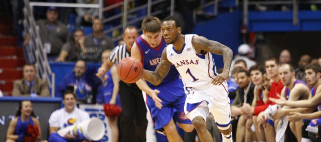 Kansas guard Naadir Tharpe pushes the ball up the court past American center Tony Wroblicky during the second half on Saturday, Dec. 29, 2012 at Allen Fieldhouse.