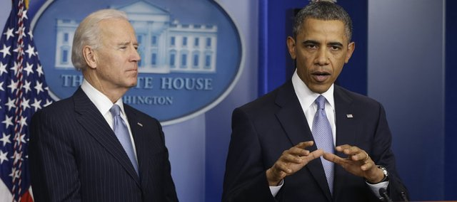 President Barack Obama and Vice President Joe Biden make a statement regarding the passage of the fiscal cliff bill in the Brady Press Briefing Room at the White House in Washington, Tuesday, Jan. 1, 2013.