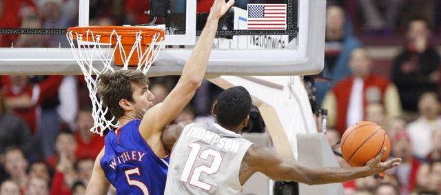 Kansas center Jeff Withey looks for a block against Ohio State forward Sam Thompson during the first half on Saturday, Dec. 22, 2012 at Schottenstein Center in Columbus, Ohio.