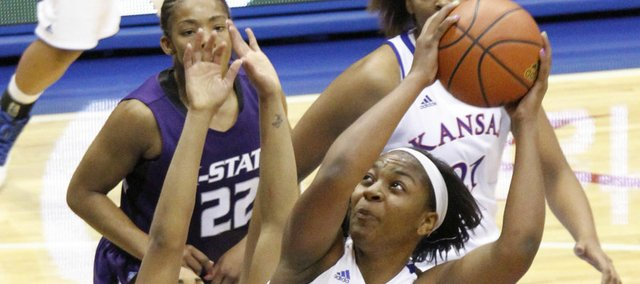 Bunny Williams (5) looks to shoot over Ashia Woods (23) in the Jayhawks 72-63 win over the Kansas State in Allen Fieldhouse, Wednesday, January 2, 2013.