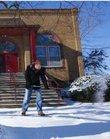 Derek Jensen, a volunteer with the Theatre Lawrence, tosses a pile of snow from the sidewalk in front of the old building at 1501 New Hampshire on Wednesday, Jan. 2, 2013. Lawrence residents are reminded to shovel their sidewalks to avoid a citation from the city. Nick Krug/Journal-World Photo