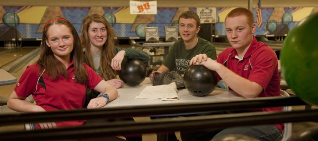 Saturday, Jan. 5, 2013, marks the beginning of the season for many of the city's bowlers, including, from left, Lawrence High senior Rebecca McNemee, Free State seniors Hannah Stegall and Chase Taylor, and LHS senior Austin Bennett.