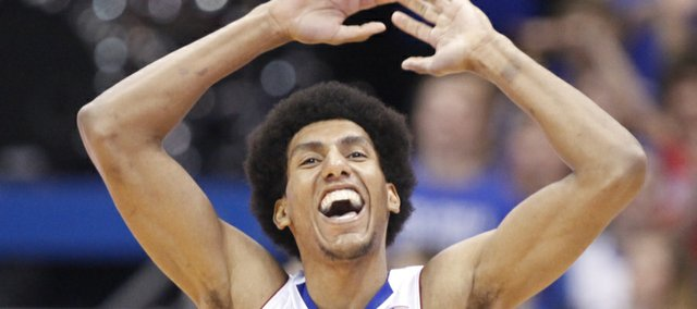 Kansas forward Kevin Young celebrates a dunk by center Jeff Withey against Belmont during the second half on Saturday, Dec. 15, 2012 at Allen Fieldhouse.