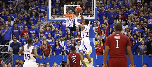 Kansas guard Ben McLemore soars in for a dunk before the student section late in the game against Temple on Sunday, Jan. 6, 2013 at Allen Fieldhouse.