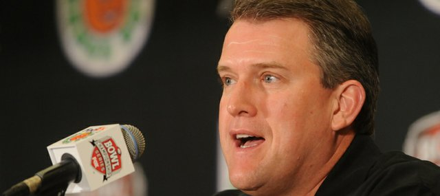 Former Kansas offensive coordinator Ed Warinner gives opening comments during a press conference Monday, Dec. 31, 2007 at the Hyatt Regency Hotel in Fort Lauderdale, Florida.