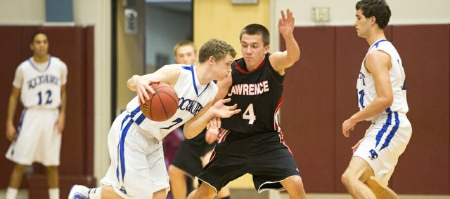 Lawrence High senior Austin Abbott (4) applies defensive pressure against Connor Kuhlmann during Lawrence High's game against Rockhurst, Saturday, Jan. 5, 2012 at Rockhurst.
