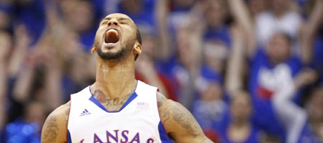 Kansas guard Travis Releford roars after a three late in the game against Temple on Sunday, Jan. 6, 2013 at Allen Fieldhouse.