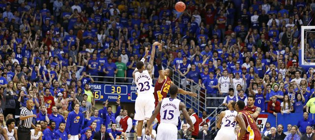 The fieldhouse watches as Kansas guard Ben McLemore puts up the game-tying three over Iowa State guard Tyrus McGee with three seconds left in regulation on Wednesday, Jan. 9, 2013. McLemore&#39;s three sent the game into overtime where the Jayhawks defeated the Cyclones 97-89.