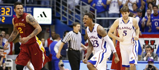 Kansas guard Ben McLemore celebrates a bucket next to Iowa State guard Chris Babb as the Jayhawks make a run during the second half on Wednesday, Jan. 9, 2013 at Allen Fieldhouse.