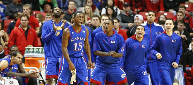 Kansas guard Elijah Johnson (15) and the bench celebrate a bucket by the Jayhawks against Texas Tech during the first half on Saturday, Jan. 12, 2013 at United Spirit Arena in Lubbock, Texas.