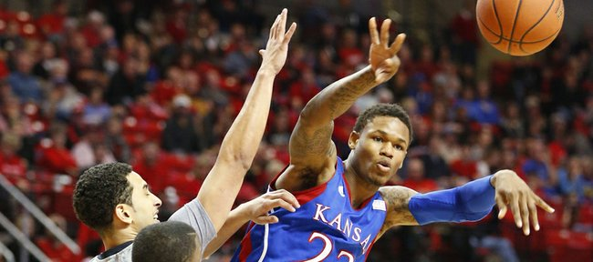 Kansas guard Ben McLemore passes as he is defended by Texas Tech guards Ty Nurse and Daylen Robinson during the second half on Saturday, Jan. 12, 2013 at United Spirit Arena in Lubbock, Texas.