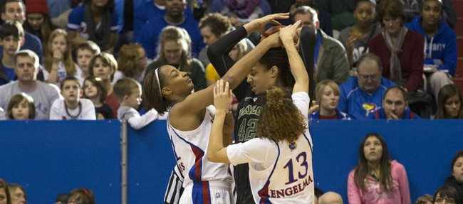 Kansas players Carolyn Davis, left, and Monica Engelman (13) double team Brittney Griner (42) during Kansas' game against Baylor, Sunday, Jan. 13, 2013 at Allen Fieldhouse.