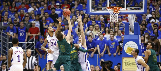 Kansas players Travis Releford (24) and Jeff Withey get in the face of Baylor guard Brady Heslip during the first half on Monday, Jan. 14, 2013 at Allen Fieldhouse.