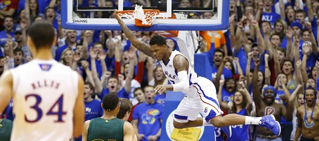 Kansas guard Ben McLemore swings off the rim after a dunk against Baylor during the second half on Monday, Jan. 14, 2013 at Allen Fieldhouse.