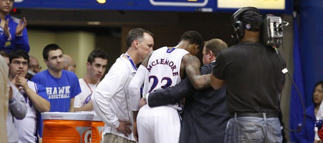 Fans watch as Kansas guard Ben McLemore is helped into the lockerroom late in the second half on Monday, Jan. 14, 2013 at Allen Fieldhouse.