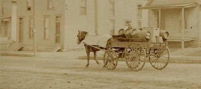 This photo from an unknown location depicts an everyday scene from the early days of Kansas breweries, when kegs of beer were delivered around town — and empties picked up — by horse and wagon.