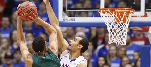 Kansas forward Perry Ellis gets up to block a shot by Baylor center Isaiah Austin during the first half on Monday, Jan. 14, 2013 at Allen Fieldhouse.