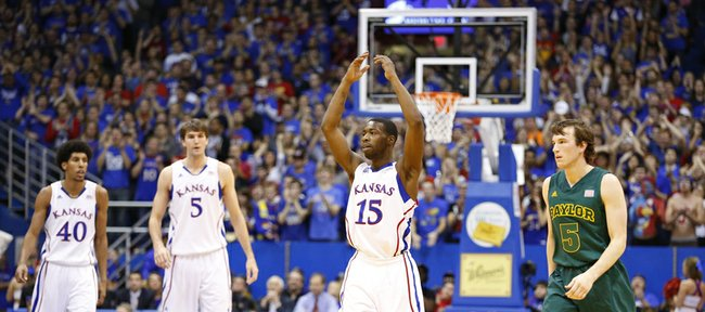 Kansas guard Elijah Johnson raises up the crowd after a Jayhawk bucket during the first half on Monday, Jan. 14, 2013 at Allen Fieldhouse. At right is Baylor guard Brady Heslip.