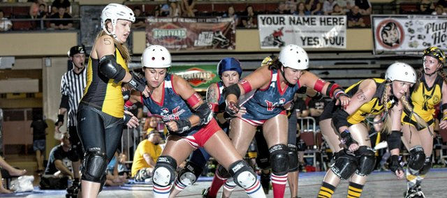 As this glimpse at a 2012 Victory Vixens bout shows, Kansas City Roller Warriors competition can get fierce.