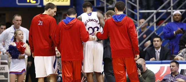 Kansas Ben McLemore is escorted off the court by teammates Christian Garrett, left, Niko Roberts and Evan Manning, right, along with trainer Bill Cowgill after the freshman guard went down with an ankle injury late in the second half against Baylor on Monday, Jan. 14, 2013, at Allen Fieldhouse.