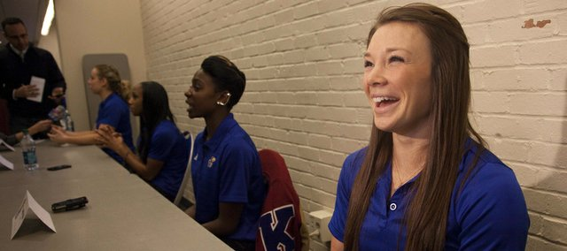 Andrea Geubelle, right, answers a question during Kansas University's track and field media day on Thursday, Jan. 17, 2013, at Allen Fieldhouse.