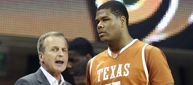 Texas men's basketball coach Rick Barnes, left, talks with Cameron Ridley in the first half of a NCAA college basketball game against Baylor, Saturday, Jan. 5, 2013, in Waco, Texas.