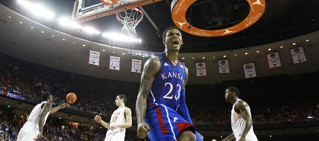 Kansas guard Ben McLemore roars after dunking against Texas during a comeback run by the Jayhawks late in the second half on Saturday, Jan. 19, 2013 at Frank Erwin Center in Austin, Texas.