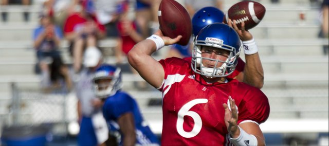 Kansas quarterback Turner Baty looks to the sideline to make a pass during a drill at the Fan Appreciation Day open practice Saturday, Aug. 11, 2012, at Memorial Stadium.