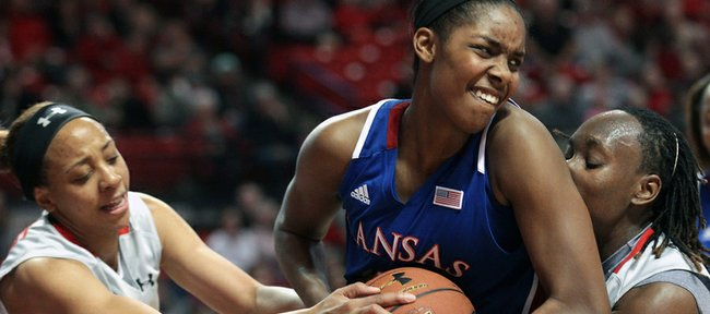 Kansas' Chelsea Gardner, center, battles with Texas Tech's Shauntal Nobles, left, and Chynna Brown for a rebound during the Red Raiders' 70-63 victory Saturday, Jan. 19, 2013, in Lubbock, Texas.