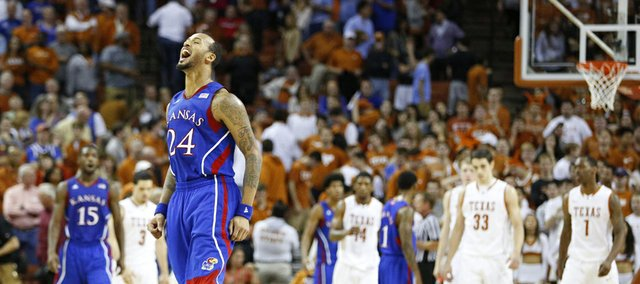 Kansas guard Travis Releford celebrates as time expires in the Jayhawks&#39; 64-59 comeback win against Texas on Saturday, Jan. 19, 2013 at Frank Erwin Center in Austin, Texas.