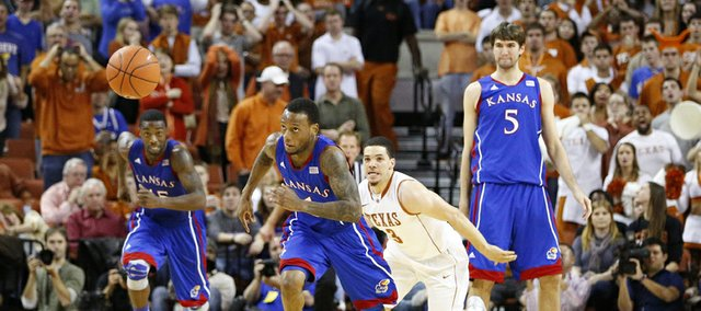 Kansas guard Naadir Tharpe chases down a loose ball past Texas guard Javan Felix late in the second half on Saturday, Jan. 19, 2013 at Frank Erwin Center in Austin, Texas.