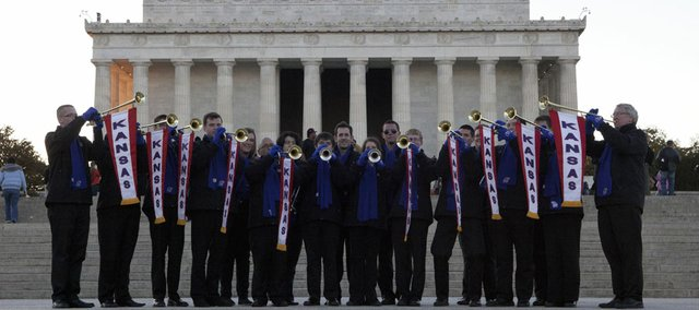 Members of the Kansas University Trumpet Ensemble show off their Kansas University banners on the steps of the Lincoln Memorial in Washington, D.C.