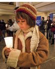 Helen Henry, 7, of Lawrence, gets ready for a candlelight vigil from Strong Hall on the Kansas University campus to the Kansas Union. Dozens of people took part in Monday's vigil honoring slain civil rights leader Martin Luther King Jr.