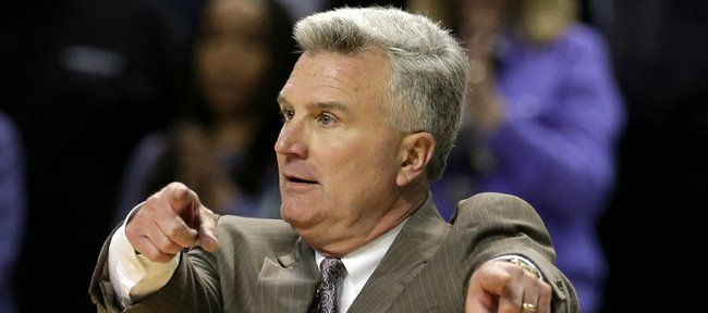 Kansas State coach Bruce Weber gestures to players during the second half of a game against Oklahoma State Saturday, Jan. 5, 2013, in Manhattan.