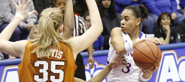 Angel Goodrich (3) drives into the lane before passing during the Jayhawks 76-38 win against the Texas Longhorns Wed, Jan. 23, 2013, at Allen Fieldhouse. Goodrich scored 20 points and passed the 1,000 point mark in her Jayhawk career.