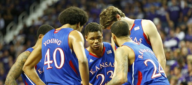 Kansas guard Ben McLemore, center, leans in as he and the Jayhawk starters huddle late in the game against Kansas State on Tuesday, Jan. 22, 2013 at Bramlage Coliseum.