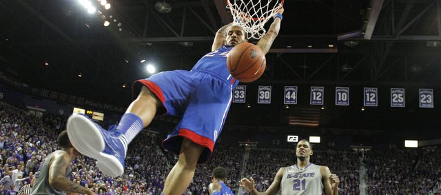Kansas guard Travis Releford finishes a dunk against Kansas State during the second half on Tuesday, Jan. 22, 2013 at Bramlage Coliseum.