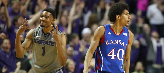 "Kansas State guard Shane Southwell signals ""three"" after hitting one over Kansas forward Kevin Young during the first half on Tuesday, Jan. 22, 2013 at Bramlage Coliseum."