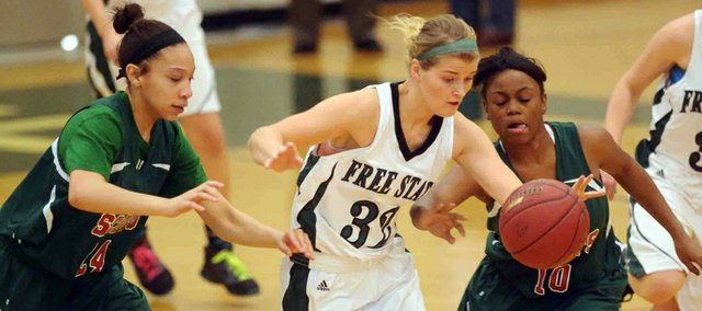 Free State senior Chelsea Casady (32) makes a steal on Topeka Highland Park's Emmiley Springfield (24) during the FSHS girls' first game of the Firebird Winter Classic on Thursday, Jan. 24, 2013, at FSHS.