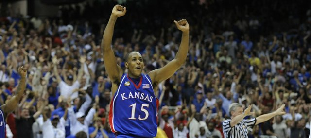 Kansas' Mario Chalmers and Sherron Collins celebrate after beating Memphis on Monday, April 7, 2008 at the Alamodome in San Antonio, Texas.