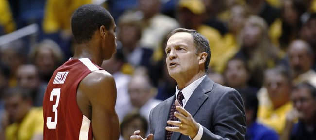 Oklahoma coach Lon Kruger speaks with Buddy Hield during a second-half break in an NCAA college basketball game against West Virginia on Saturday, Jan. 5, 2013, in Morgantown, W.Va. Oklahoma won 67-57.